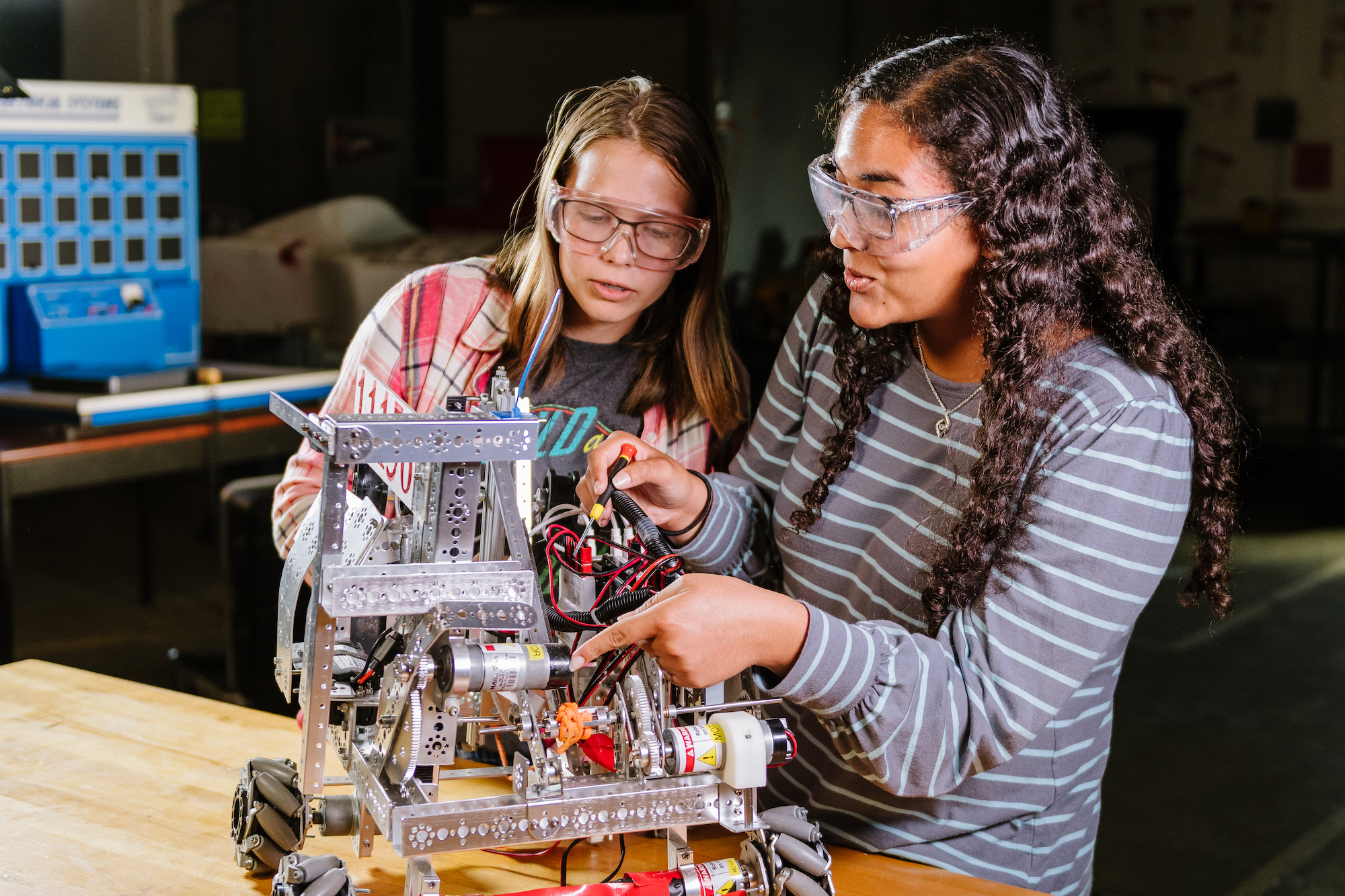 Two girl engineering students building a project
